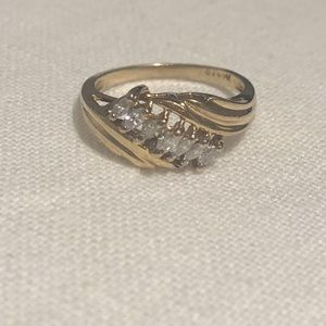 14kt yellow gold with 7 Marquis shape diamonds